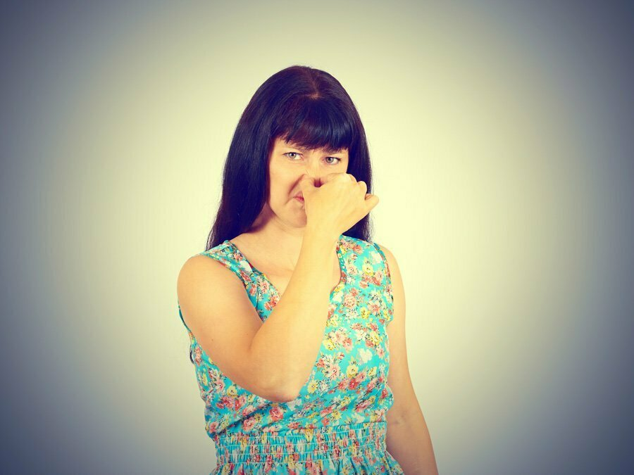 Woman Holding Nose